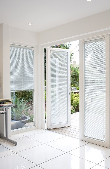Garden room white doors with integral blinds
