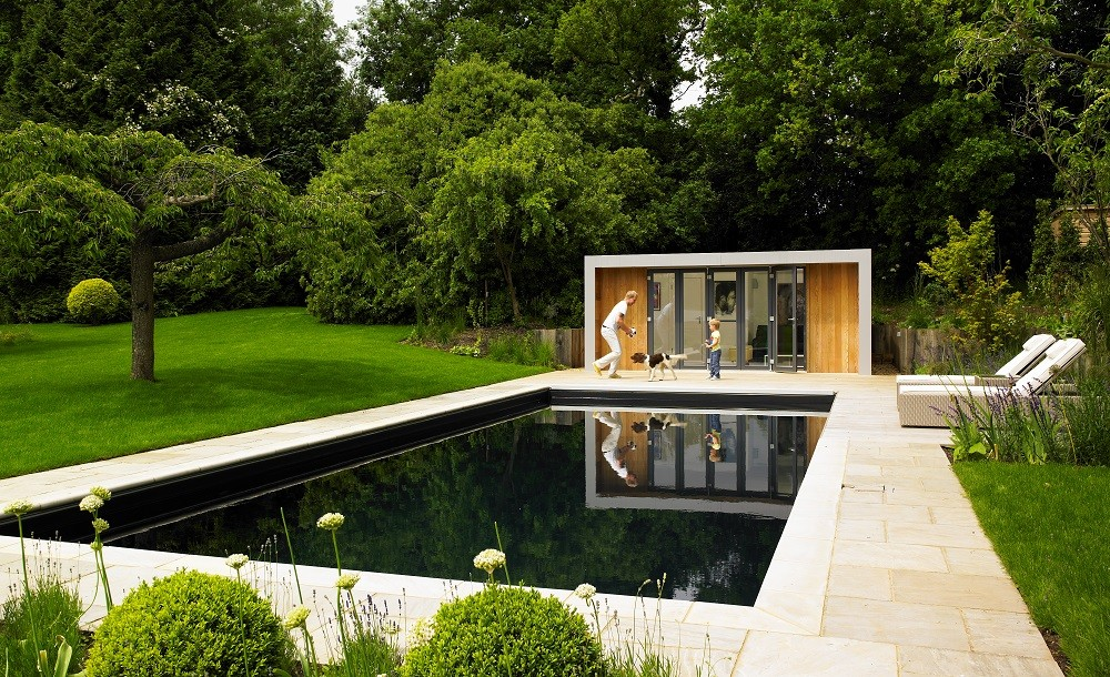 Garden room within a landscaped garden with swimmingpool