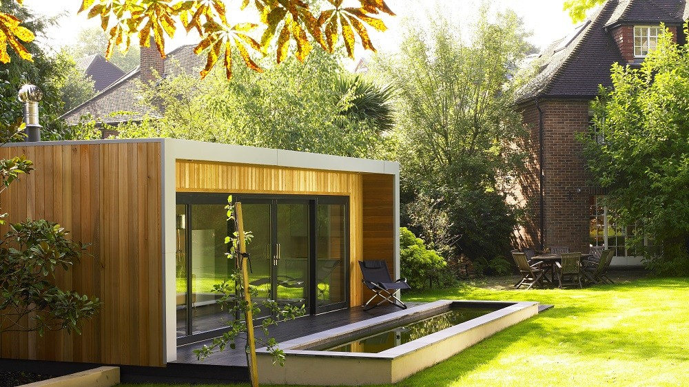 Cuberno garden room with Western red Cedar cladding in a landscaped garden