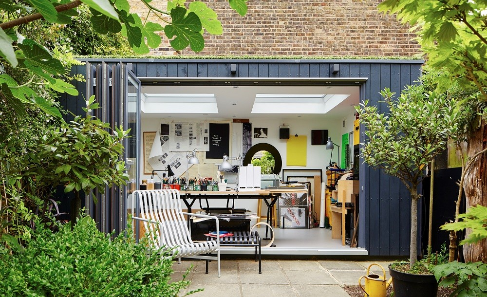 Bespoke garden office with composite cladding, green roof and bifolding doors
