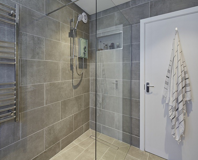 Holiday home shower room in Wales with concrete tiles