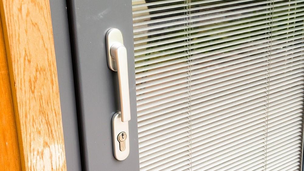 Garden room door with integral blind