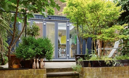 Creative working space in Islington with a grey cladded garden room