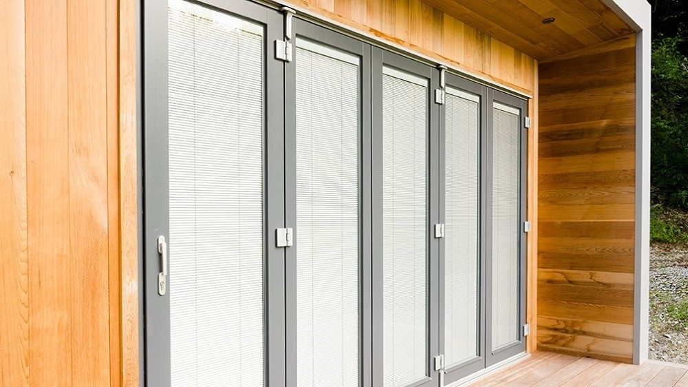 Bifolding doors with integral blinds for a Cuberno garden studio