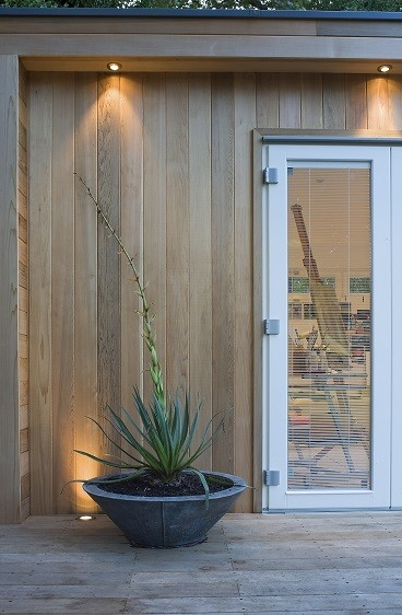 Garden studio with Western Red Cedar cladding and white bifolding doors