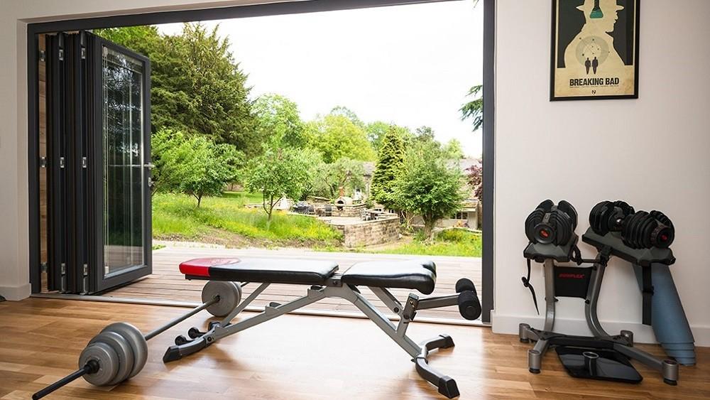 Garden home gym with bifolding doors