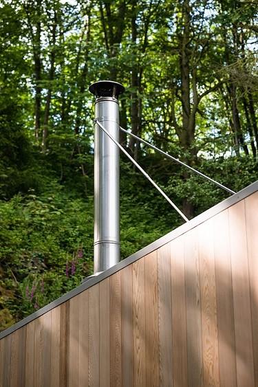 Garden studio cladded in Western Red Cedar inclusive of a wood burner