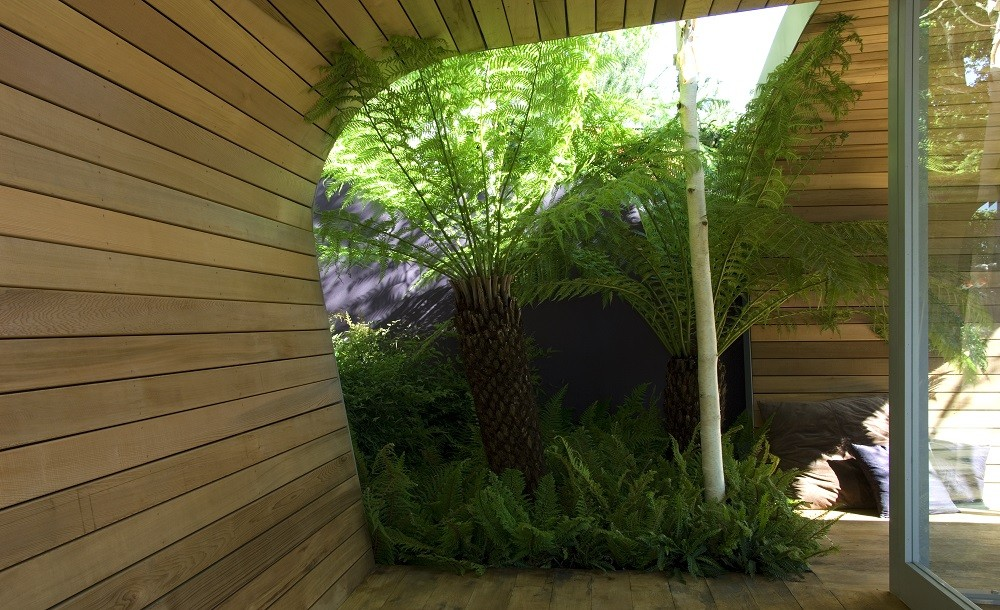 Curved cedar walls of a garden room