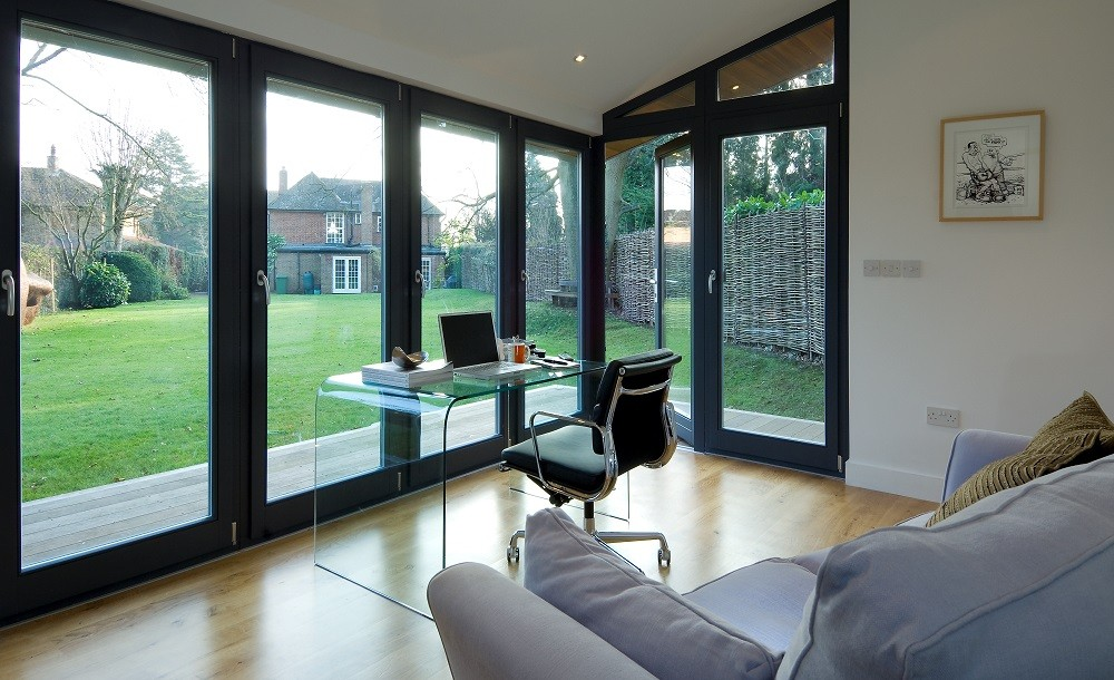 Bright bespoke garden office with glazing