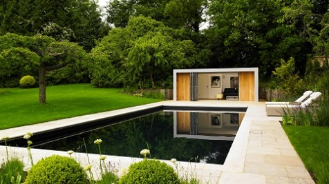 Garden room reflected in a Cookham swimming pool