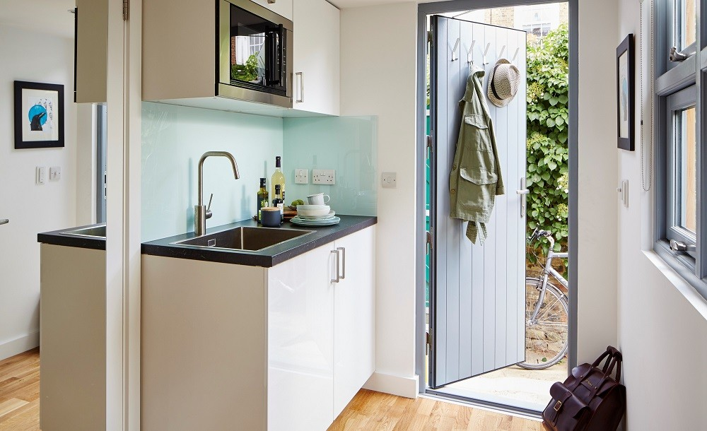 Compact kitchenette in a self contained garden studio