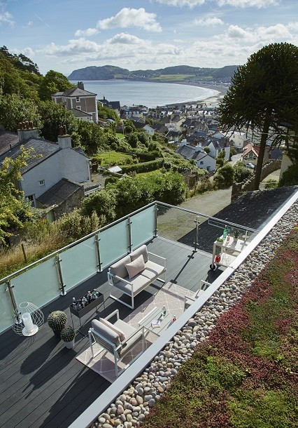 Garden room with extended deck and green roof, overlooking the bay