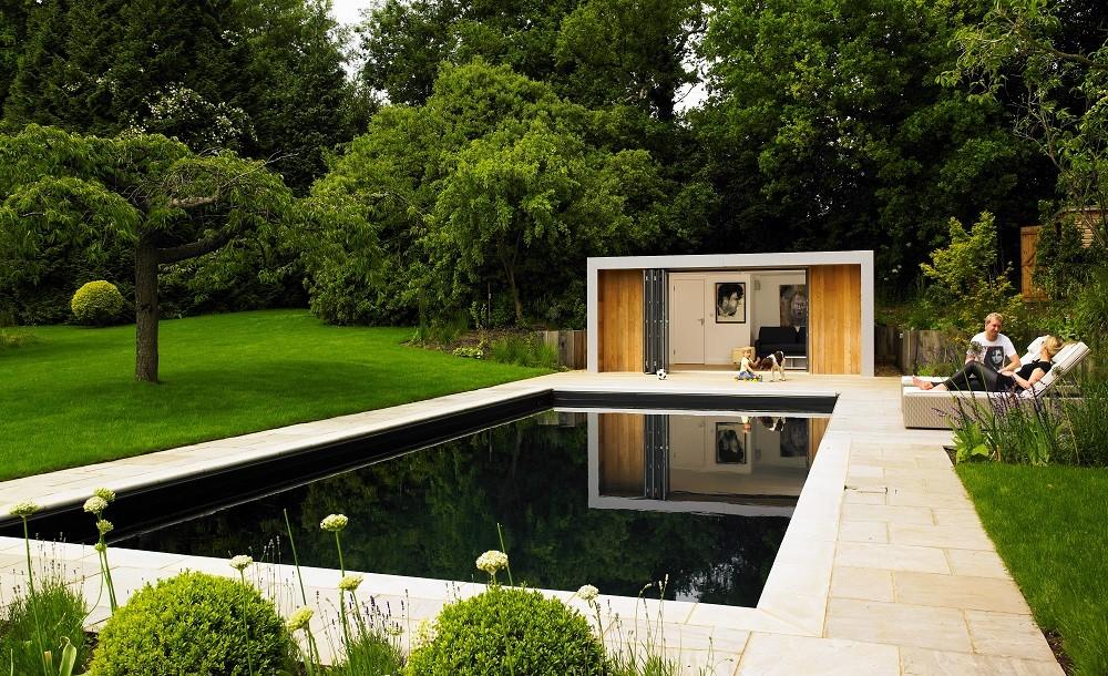 Garden poolside room with dark swimmingpool