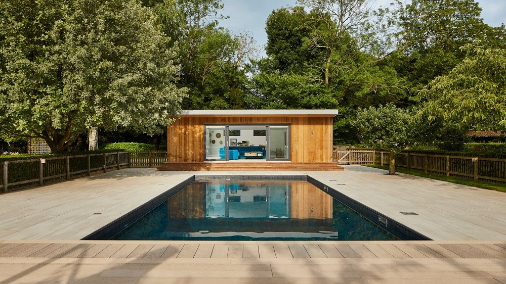Pool side room with swimmingpool in Essex