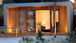 Cuberno garden room with aluminium frame and ecorative matching dots on a Western Red Cedar facade
