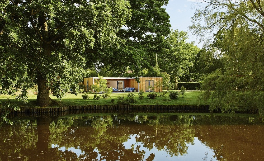 L shaped guest house by the pond