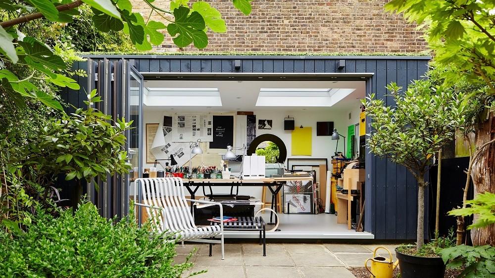 Bespoke garden office with dark cladding and bifolding doors